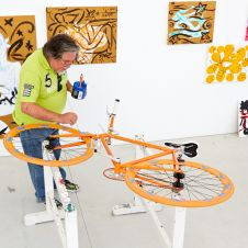 Art-Bike by Stefan Szczesny, handpainted bicycle orange, photo with artist