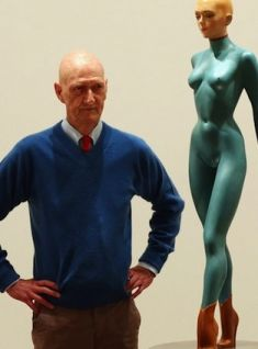 Allen Jones poses next to his sculpture